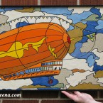 Zeppelin (medium) Recycled paper-tile mosaic. $361 Framed; 29.7518 232 tile pieces. tax-free. (the flag is the Independence flag from the show Firefly)