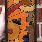 Gears (mini vertical). Recycled paper-tile mosaic. 59 pieces. $321 tax-free. 5″Wx14″H