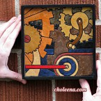 Gears, mini detail 1. 58 paper tiles. $105. Includes framing. Tax-free. 7.5″x7.5″ Very reasonable shipping available.