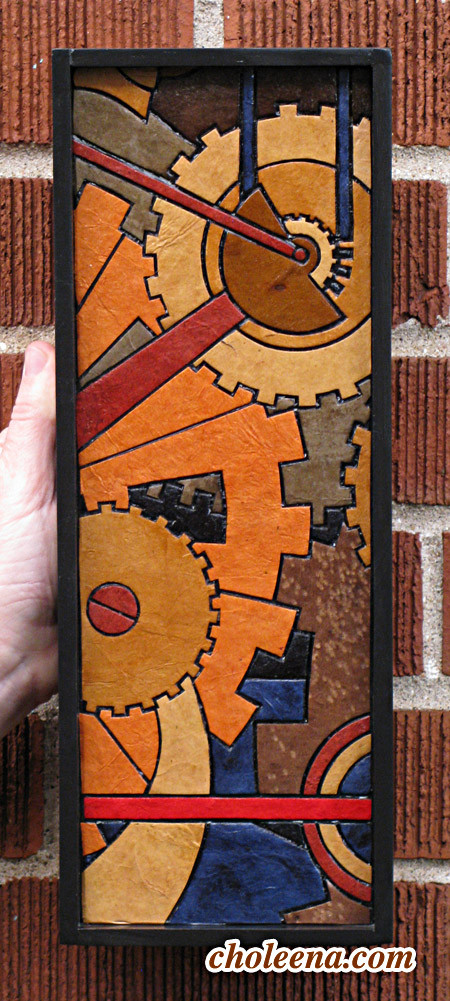 "Gears (mini vertical). Recycled paper-tile mosaic. 59 pieces. $107 tax-free. 5""Wx14""H. Very reasonable shipping available."